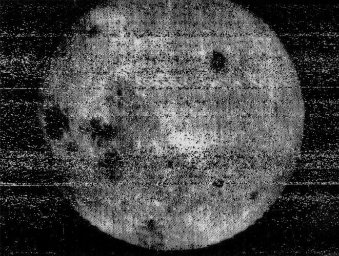 <p><strong>The Dark Side Of The Moon</strong><br /> Russia's Luna 3 spacecraft returned the first views ever of the far side of the Moon. The first image was taken at 03:30 UT on 7 October at a distance of 63,500 km after Luna 3 had passed the Moon and looked back at the sunlit far side. The last image was taken 40 minutes later from 66,700 km. A total of 29 photographs were taken, covering 70% of the far side. The photographs were very noisy and of low resolution, but many features could be recognized. This is the first image returned by Luna 3.</p>