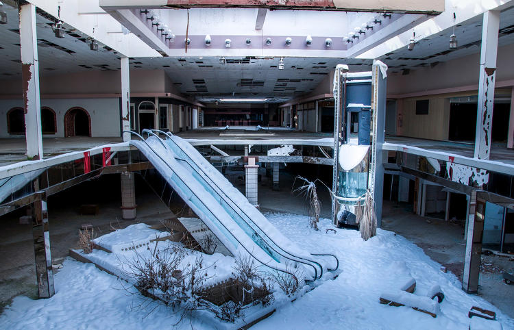 Surreal Photos Of Abandoned Snow Filled Malls Show The