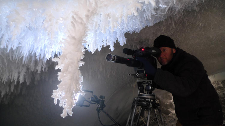 <p><strong>THE CRYSTAL CATHEDRAL. </strong>  Beneath Mt. Erebus lies a labyrinth of previously unexplored ice crystal caves. To shoot that sequence, director Chadden Hunter and cameraman Gavin Thurston (shown here) used straight scope macro lens cameras for extremely close-up shots of the crystals. They also used special LED lights, which do not give puff heat, and mounted cameras on tracks so they could move around the crystals for a 3D effect. Spending 14-hour days filming, the crew suffered severe headaches from high levels of volcanic gases in the caves.</p>