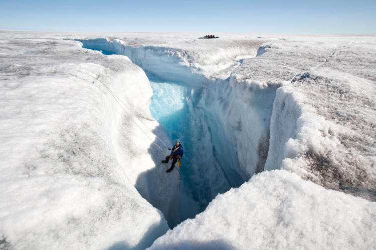 <p><strong>SIGNS OF GLOBAL WARMING.</strong>  Another series mandate was to show proof of global warming--and how the rapidly melting glaciers are disrupting ecosystems. Camerawoman Justine Evans descends into a creaking ice shaft to film the waterfall caused by a melting glacier. The deafening sounds from the ice and waterfall required communication by sign language.</p>