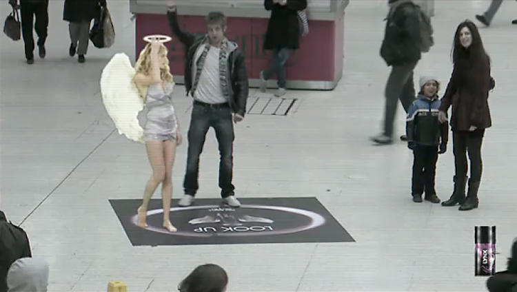 "<p>AUGMENTED REALITY: Lynx Excite ""Angels Will Fall""</p>  <p>For your average Axe man, if given the choice of how to augment their reality, they'd likely choose a scarcely clad young woman. Thank heavens for the Lynx ""Angels Will Fall"" augmented reality project then, which allowed passersby in London's Victoria station and outside the Bullring Shopping Centre in Birmingham to virtually interact with a fallen angel when standing on a halo positioned in front of a large digital outdoor screen. Bartle Bogle Hegarty and out-of-home agency Kinetic created the stunt to promote Lynx Excite body spray. See the video <a href=&quot;http://www.youtube.com/watch?v=rFuUFeQIdpk&quot; target=&quot;_blank&quot;>here</a>.</p>"