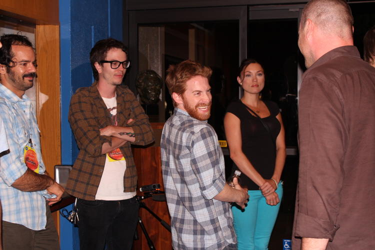 <p>Several celebrity space enthusiasts made appearances. Here, <em>Robot Chicken</em> creator/executive producer Seth Green jokes with Brandon Fibbs of Morgan Freeman's Revelations Entertainment.</p>