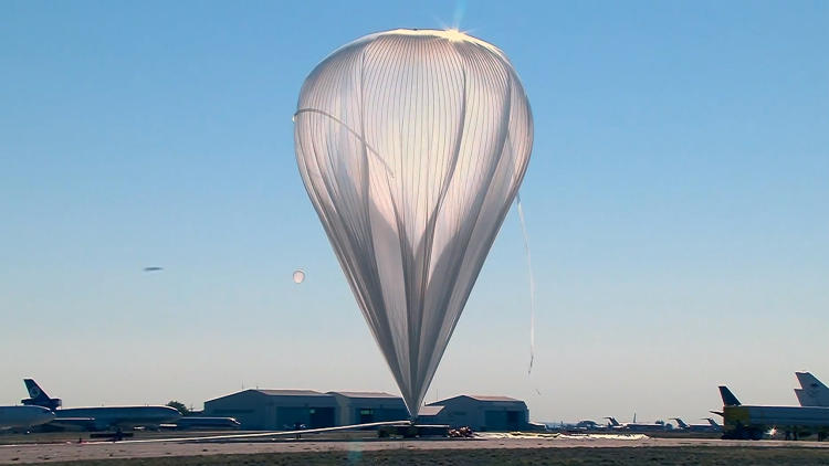 <p>The balloon that lifted the capsule into space was made of strips of plastic 0.0008 inches thick. If laid flat, the plastic would cover 40 acres and when filled first filled, was 55 stories high.</p>