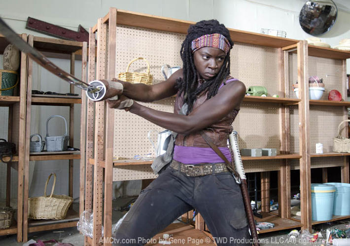 "<p>""Michonne [Danai Gurira] is my superhero!"" laughs Womble. ""All the character study went out the window and I just had fun with her design. The best thing that happened all season was that we shot in a deer-processing plant. There was a ton of leather, so I grabbed a few pieces. What's a superhero without leather? She has a burlap sack converted into a cape, boots with studs, an African warrior headband, and an 'M' in rose gold on a silver chain--like an emblem. I grew up with African prints and was influenced by the way tribes put clothing together, and Danai grew up in Zimbabwe, so we had that reference in common.""</p>"