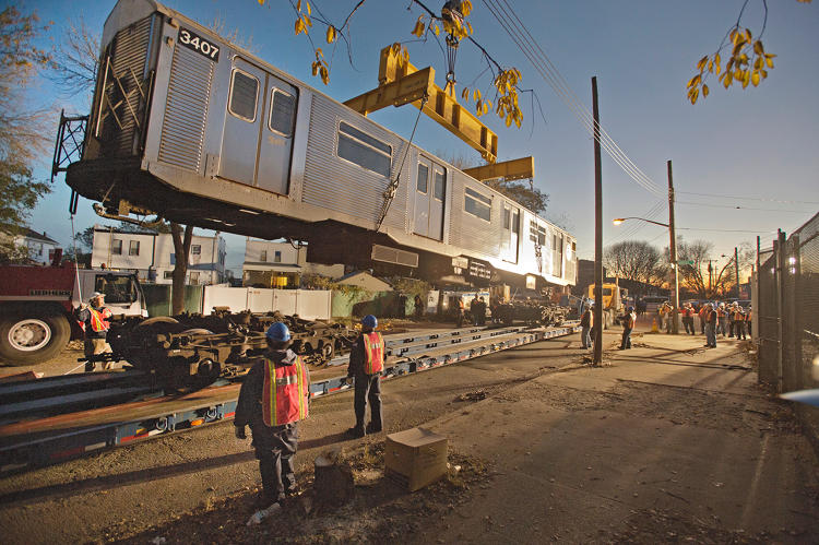 <p>A train car being transported to the Rockaways. Photo: Patrick Cashin.</p>