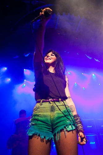 <p>Alexis Krauss looked every bit the sugary-sweet noise-punk rocker on stage during Sleigh Bells' set.</p>