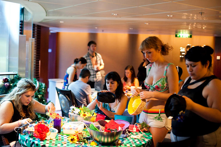 <p>At the Boats &amp; Crafts activity, cruise mates adorned jaunty sailors caps with flowers, lights, lace, and in some cases, small dolls.</p>
