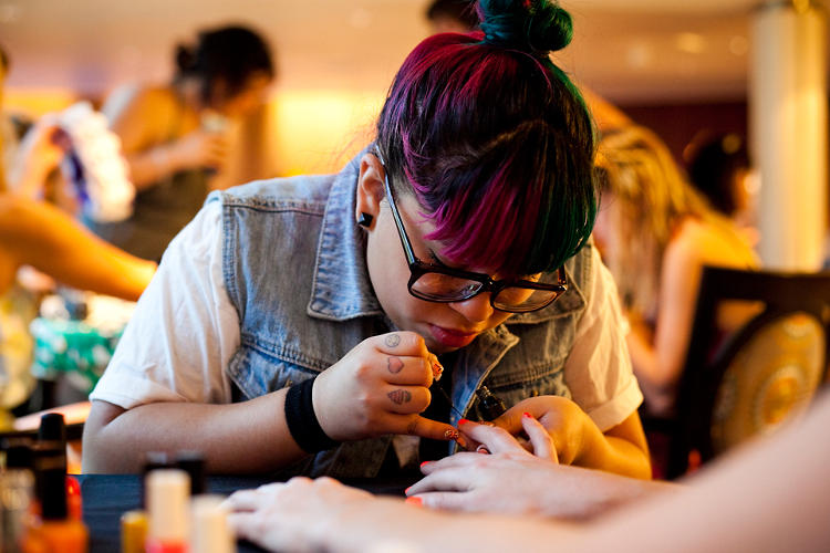 <p>Nail artist Ria Lopez gets to work on tiny finger canvasses.</p>