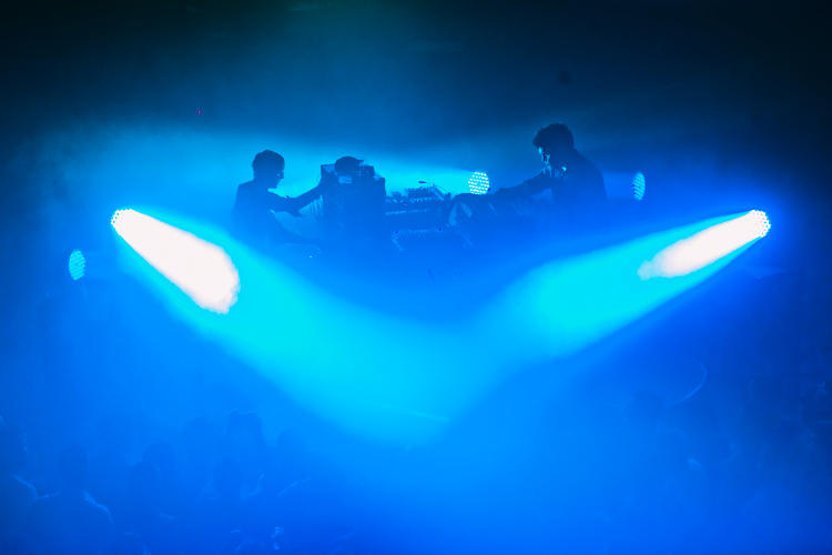 <p>Simian Mobile Disco looked like musical engineers, with decks and wired switchboards center stage during an intense dance set.</p>