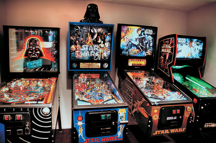<p>At the end of a long work day, when there's some time to kick back, it's great to go into the <em>Star Wars</em> Arcade and shoot some pinball or play a video game—all set on free play. The first Star Wars arcade game is the pinball game at the far left; it was made in Australia in 1982.</p>