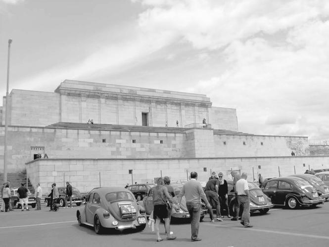 <p>Beetles parked in front of the grandstand in the former Nazi party rally grounds during the 2011 meet in Nuremberg. Aware of the historically charged location, the organizers offered critical tours of the site, which the city of Nuremberg uses for numerous outdoor events.</p>