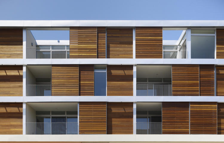 <p>Eye-catching mangaris wood screens front this low-slung complex of condos, studios, retail, and parking in West Hollywood, California. By Koning Eizenberg Architecture</p>