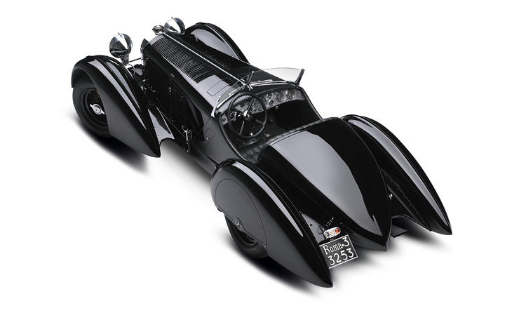 <p>The archetypal Mercedes of the 1920s, the SSK is defined by its massive, tapered hood, which stretches more than half the car's length and has a radiator projecting from its front as a windbreak. It's a villainous-looking thing and has an explosive temperament to match. With a seven liter straight 6 cylinder engine, it can reach speeds up to 146 miles per hour. Lauren's model was built for the aristocratic industrialist Count Carlo Felice Trossi.</p>