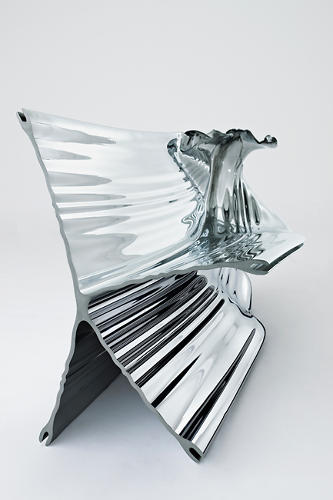 <p>Here, Thomas Heatherwick Studio drew on a complex aluminum-extrusion process to build a chair out of a single component. (Most chairs are made up of several parts and require additional fittings and hardware.)</p>