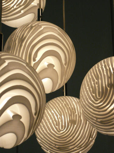 <p>Designer Dan Yeffet's own fingerprint served as the model for these whimsical hanging lampshades.</p>