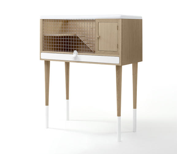 <p>This Danish-style hutch offers a couple of places to stash food and supplies, including a long drawer with a ceramic knob featuring a stylized head of a rabbit, mouse, or hamster.</p>