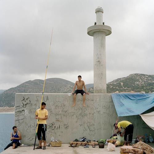 <p>Irish photographer Ivor Prickett captures a handful of young men relaxing in the harbor at Ras Hilal, which Gaddafi commissioned for private use. Before the revolution, the public was forbidden from entering the harbor.</p>