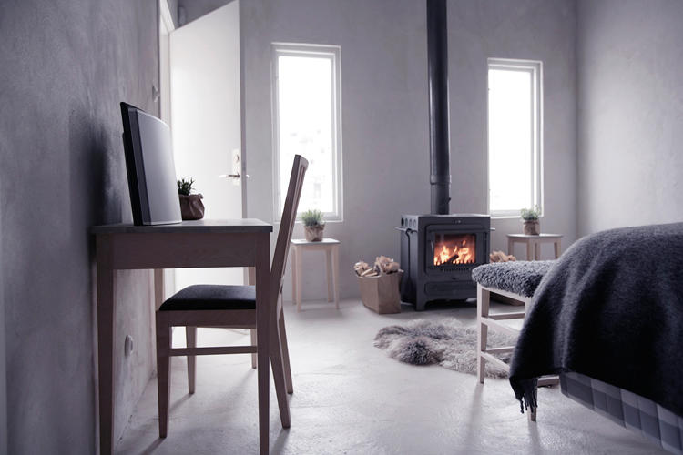 <p>Logs are provided in all standard rooms to stoke the wood-burning furnace. Add in beds by Hästens, a Bang &amp; Olufsun sound system, and interior design that's just so, and this--the most basic option at Fabriken Furillen--is looking pretty damn good.</p>