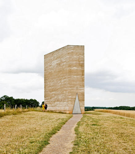 <p>Peter Zumthor has described the material of his Bruder Klaus Chapel in Germany as &quot;rammed concrete&quot; in part because it bears such an uncanny resemblance to <a href=&quot;http://www.inhabitat.com/wp-content/uploads/rammedearth.jpg&quot; target=&quot;_blank&quot;>rammed earth</a>. The structure was made by building a tepee out of trees, then enveloping it in thin, hand-compressed layers of concrete stacked on top of each other. Image via <a href=&quot;http://www.archdaily.com/106352/bruder-klaus-field-chapel-peter-zumthor/&quot; target=&quot;_blank&quot;>Arch Daily</a>.</p>