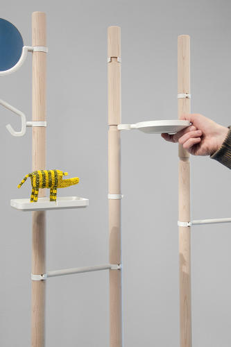 <p>Each widget is attached to a dowel that plugs into the wooden pole.</p>
