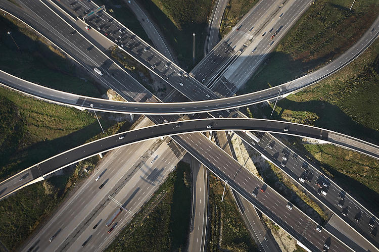 <p>Andrew charters a small plane to capture his images, which he snaps while hanging out the window.</p>