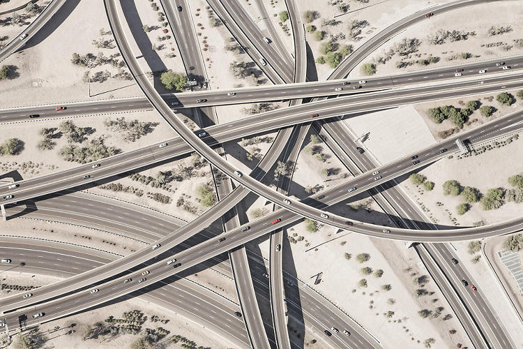 <p>Photographer Peter Andrew likens the interstate to a cardiovascular system, where cars are blood cells and roads are arteries.</p>