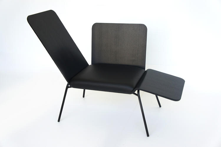 <p>Made of bent plywood and leather, the Office Lounge has side panels that can be folded up or down, allowing the sitter to shift from an upright to a resting position. By Damee Hong.</p>