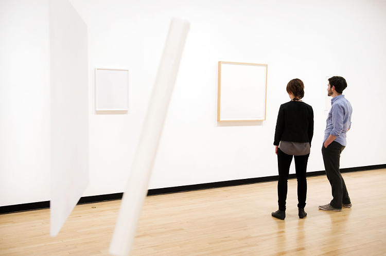 <p>Tom Friedman's <em>1000 Hours of Staring </em>(1992-97), is described in the title card as &quot;stare on paper.&quot; Friedman stared at the page for five years to create the piece. Photo courtesy of Linda Nylind.</p>