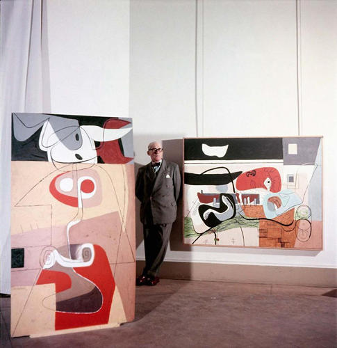 <p>Here, Le Corb stands in the galleries of the Musée National d'Art Moderne, where a show of his paintings was being hung.</p>
