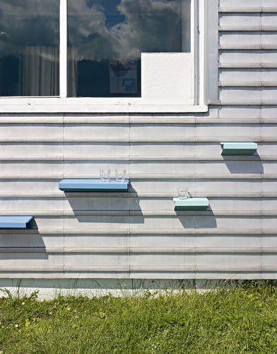 <p>Each student designed an item for a specific spot on the property; Alice Speiser's Clic Lac shelves attach to the exterior metal cladding.</p>