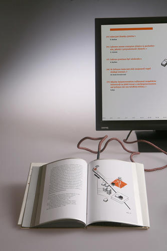 <p>Thanks to pages silkscreened with conductive silver, as the reader moves through the text, he controls a custom-made companion website via USB.</p>