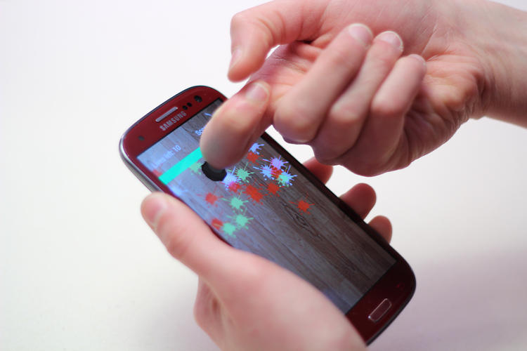 <p>In this gaming demo, FingerSense lets the user squash melons with a knuckle tap while reserving other gestures for other actions.</p>