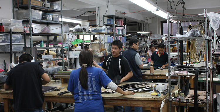 <p>Handbag production in action, as the assembly team does their thing at Baikal Inc.</p>
