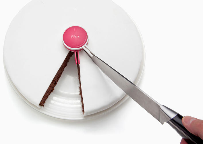 <p>Put an end to the squabbling over who got the bigger piece of cake with this <a href=&quot;http://www.fastcodesign.com/1670899/a-gadget-that-cuts-perfectly-equal-cake-slices&quot; target=&quot;_self&quot;>neato gadget</a>, which divides the sweet into 6, 8, 10, or 12 perfectly equal slices. It's a steal at <a href=&quot;http://www.animicausa.com/shop/Kitchen-and-Tabletop/Cake-Divider/tpflypage.tpl.html&quot; target=&quot;_blank&quot;>$14</a>.</p>