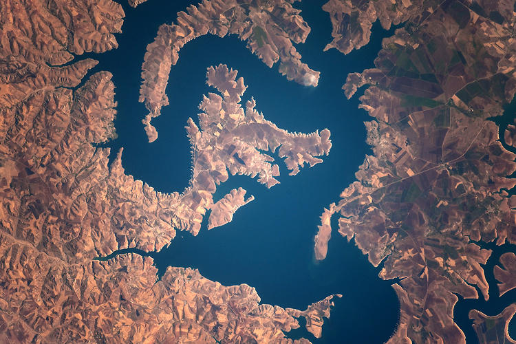 <p>A photo shows the snaking Euphrates River, which has transformed rapidly since damming began in the 1960s.</p>