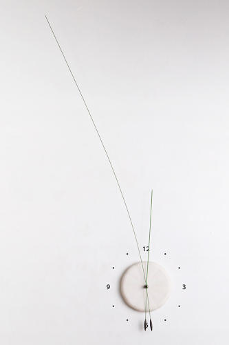 <p>The duo's last timepiece, the Manifold Clock, used shorter lengths of piano wire for its hands. There was plenty of extra in the studio, and one day, Shay Carmon started to wiggle a particularly long piece.</p>