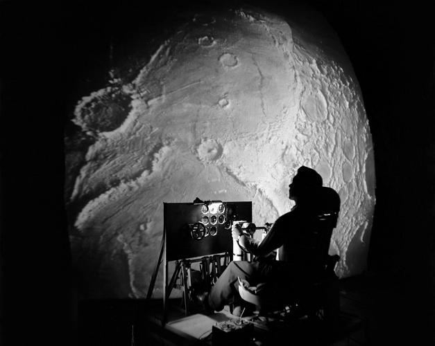 <p><strong>Inside Project LOLA</strong><br /> Test subject sitting at the controls: Project LOLA or Lunar Orbit and Landing Approach was a simulator built at Langley to study problems related to landing on the lunar surface. It was a complex project that cost nearly $2 million dollars.</p>