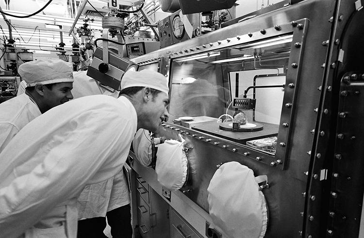 <p><strong>Moon Rocks</strong><br /> Astronaut David R. Scott, right, commander of the Apollo 15 mission, gets a close look at the sample referred to as ''genesis rock'' in the Non-Sterile Nitrogen Processing Line (NNPL) in the Lunar Receiving Laboratory (LRL) at the Manned Spacecraft Center (MSC). Scientist-astronaut Joseph P. Allen IV, left, an Apollo 15 spacecraft communicator, looks on with interest. The white-colored rock has been given the permanent identification of 15415.</p>