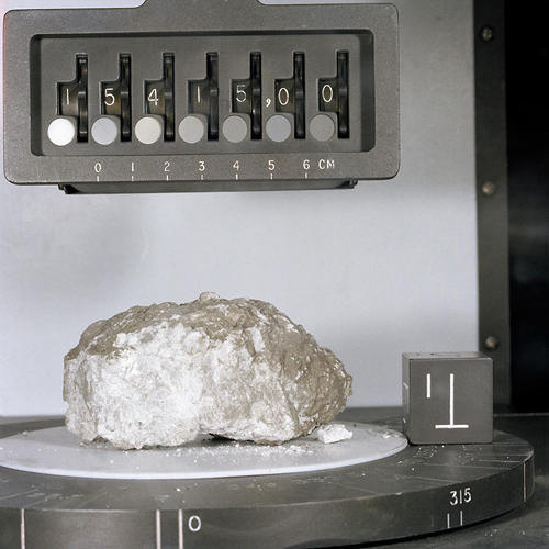 <p><strong>Genesis Rock</strong><br /> A close-up view of Apollo 15 lunar sample no. 15415 in the Non-Sterile Nitrogen Processing Line (NNPL) in the Lunar Receiving Laboratory (LRL) at the Manned Spacecraft Center (MSC). This sample is the white anorthositic rock (Genesis Rock) collected by Astronauts David R. Scott and James B. Irwin in container no. 196 at Site no. 7 at a Ground Elapsed Time of 145 hours and 42 minutes, on the mission's second extravehicular activity (EVA-2).</p>