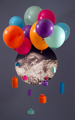 <p>Balloons (e.g., the boson) hold up other, smaller particles, illustrating how the Higgs boson gives other particles their mass.</p>