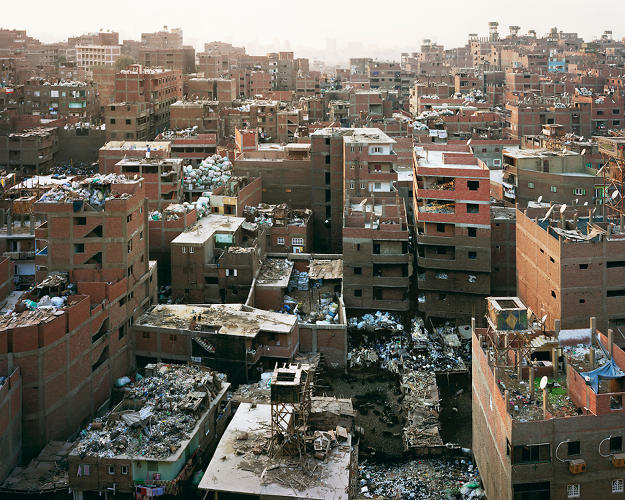 <p>Here, Bas Princen shows us the trash-littered rooftops of Manshiyat naser, or Garbage City, a neighborhood in Cairo that enjoys a bustling economy based around the collection and recycling of the city's garbage.</p>