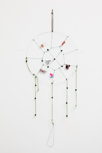 <p>Another dreamcatcher, woven with food labels.</p>