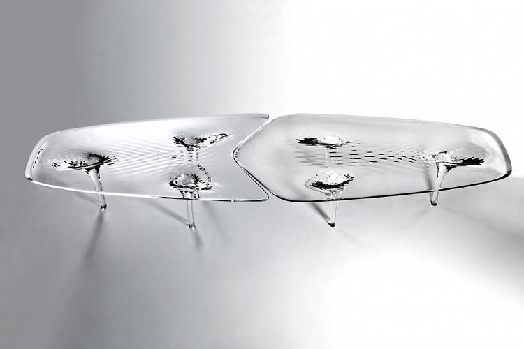 <p>The four-piece table is made of acrylic resin.</p>