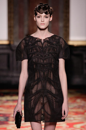 <p>For example, this cocktail dress was made using laser sintering, a fabrication technique that uses lasers to fuse together particles of plastic or resin.</p>