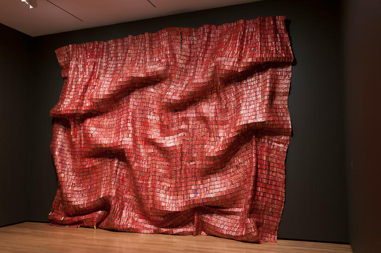 <p>Anatsui makes many of his works out of bottle and can tops collected from around Nsukka, the Nigerian city where he is based. <em>Red Block</em>, 2010.</p>