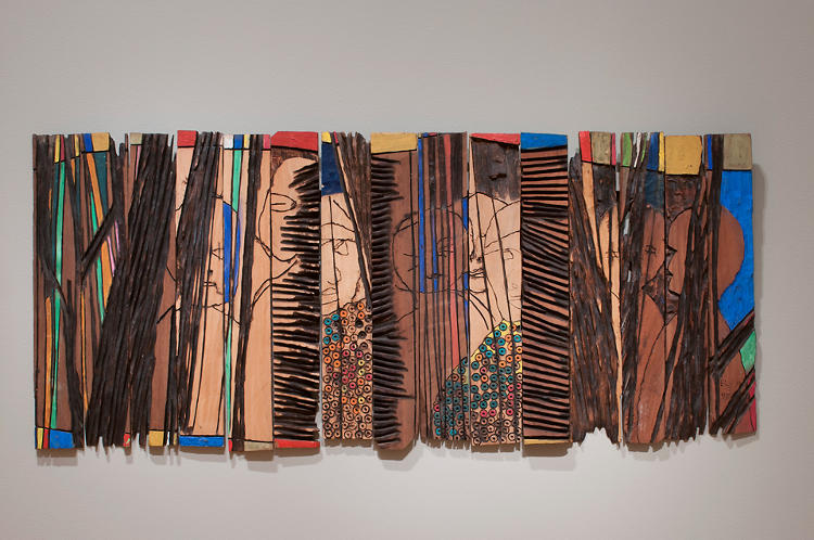 <p>Other works, like <em>Conspirators</em>, 1997, are made by fragmenting pieces of wood and ceramics--the curators are often asked to decide how to display these, too.</p>