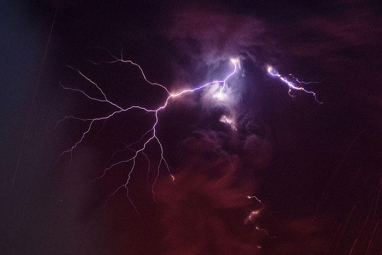 <p>Rietze captured lighting erupting from the billowing smoke and ash--an unlikely phenomenon that NASA says is not yet fully understood.</p>