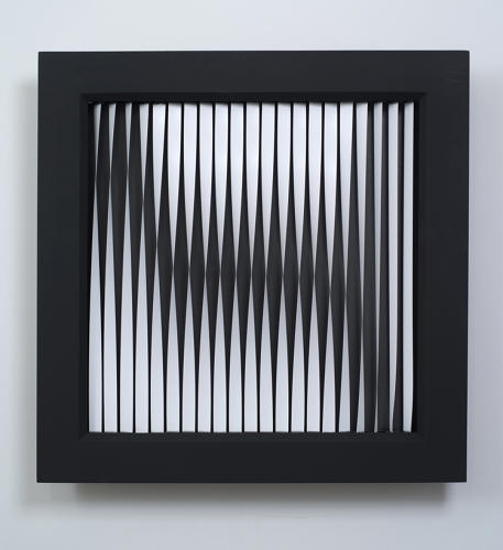 <p>In <em>Twisted Strips</em>, 2012, a line of 21 motorized strips twist and turn to form images.</p>
