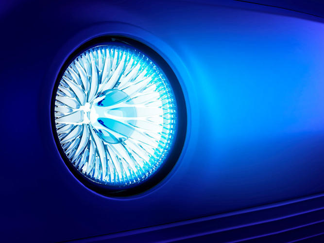 <p>The headlight casings mimic a human iris.</p>