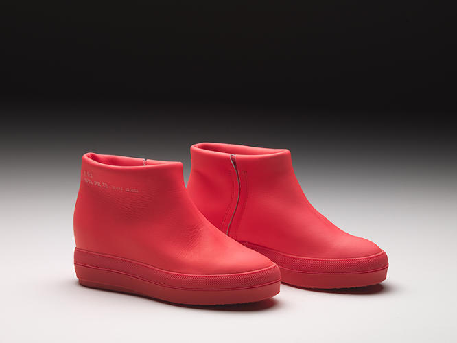 <p>The singular design detail on the boots is a text stamp on the shoe's upper, bearing the serial ID number and shoe color and style. &quot;It represents a refusal of standardization,&quot; Nouvel says.</p>